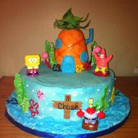 Spongebob Cake I made this for my son's birthday. 12in white cake with cookies and cream buttercream filling and the pineapple was RKT covered with...