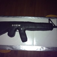 "Gun I made this for my nephews birthday. My first ""sculpted"" cake (out of 12X18 sheet) I should have over scultped it, as I forgot to..."
