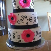 Pink Flowers With Black Swirls This was my 2nd cake covered with MMF...still not quite sure if I am a fan. I got the idea of the swirls from a cake done by nunuk (thanks...