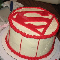 Superman A cake celebrating the MO State Long Jump champ