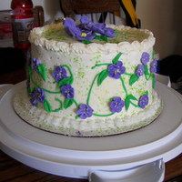 Misc Cake Buttercream frosting ith royal icing flowers.
