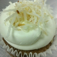 Carrot Cake Vegan carrot spice cake with pineapple buttercream. Topped with toasted coconut.