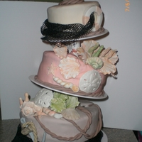 Coral Delight Three tier topsy turvy nautical themed wedding cake. Sugar paste shells, coral and sea lettuce. Sugar anchor, sea gulls, life saver, and...