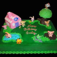 Littlest Pet-Shop Cake Chocolate cake covered with bettercreme, details are fondant and buttercream for the grass...