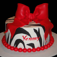 Red Bow Cake Made this cake for my sister in law, I used THE MAT to make the zebra stripes just like the you tube video of SweetWiseInc... thank you...