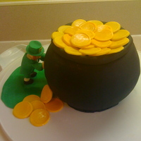 "Leprechaun Pushing His Pot Of Gold ""Pot of Gold"" made using Wilton sports ball pan, covered in fondant. Leprechaun made of fondant. All edible. A quick little cake..."