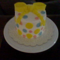 Polka Dot And Bow  Still practicing my smoothing and fondant bows. This was a just because cake, but my son says it could be a baby shower cake because of the...