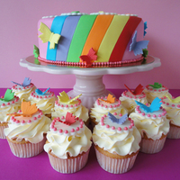 Rainbow Cake And Cupcakes Inspired by a dress from a Belgium girlband. The birthdaygirl loves them.