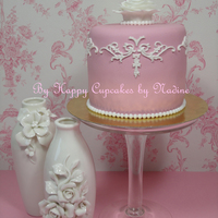 Victorian Mini-Cake Pale-pink and white cake with a white rose.