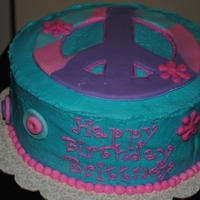 Psychedelic Peace Cake Peace sign birthday cake for 12 year old girl. Buttercream frosting, fondant accents.