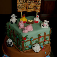 Barnyard Animal Baby Shower Cake Yummy multi layered caked with all hand crafted fondant animals, flowers, fence, sign and vines. My cake partner and I worked on this for a...