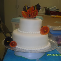 Orange And Purple Calla Lily Cake   My first doubled tiered cake. The calla lilies are fondant and gum paste mixture and then painted.