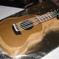 Guitar Grooms Cake Red velvet with cream cheese buttercream and fondant decorations.