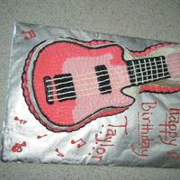 Pink Electric Guitar I made this one for a friend's daughter's 10th birthday party! I used two layers of devil's food cake in the Wilton guitar...