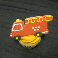 Fire Truck Cookies On Cupcakes   my oldest just turned 5 and insisted on fire engine cookies on top of cupcakes-milking me for all i've got!