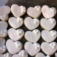 Engagement Favors   white heart cookies covered in fondant and brushed with pearl luster dust.