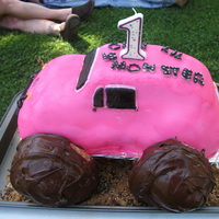 Pink Monster Truck we did this for my daughters first birthday. I used the Wiltons car pan and made it into a pink willy monster truck and used buttcream...