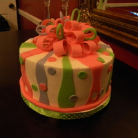 Ribbons And Bows A 2 layer white cake iced in buttercream with fondant accents and a fondant bow.