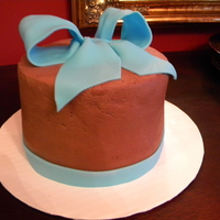 Happy Birthday! A 2 layer chocolate cake with chocolate ganache' (sp?) between the layers and iced in chocolate buttercream! The blue bow was make of...