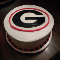 Georgia Bulldog Cake 2 layer chocolate cake iced in buttercream with the Georgia Bulldog emblem on top made of fondant.