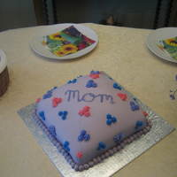 Mother's Day Cake This was only my second time covering a cake with fondant! Mom loved it!!