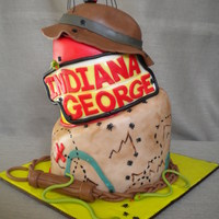 Indiiana Jones Cake Two tier topsy turvy cake in the Indiana Jones theme for a little boy named George.
