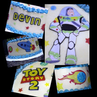 Buzz Lighyear  This cake was a joint effort, My sister made and frosted the cake and I did the fondant decorations. It was so fun to work on this together...