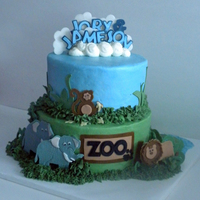 Zoo Birthday   Birthday cake for my nephew and bro. in lay who share the same b-day. Zoo theme with zoo animals.