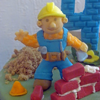 Bob The Builder  A bob the builder cake for my son's birthday. Bob and friends are made from candy clay. It was my first time working with candy clay/...