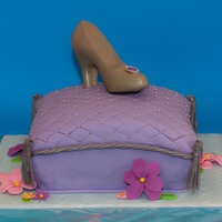 Princess Cake Shoe is made of white chocolate with a silver luster dust painted on and the cake is vanilla