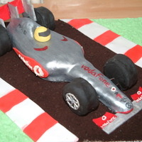 Lewis Hamilton's Mclaren F1 Car   Vanilla sponge carved and decorated with fondant.