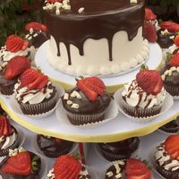 Chocolate Strawberry Cupcakes Chocolate cake with fresh strawberry filling. Iced in vanilla bean buttercream, topped with chocolate ganache, sliced strawberries, and...