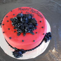Red Fondant Birthday Cake Red fondant birthday cake with black roses.