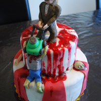 Zombie Fighting Bride & Groom Cake Client requested a two tiered Halloween cake with a bride and groom fighting off zombies.