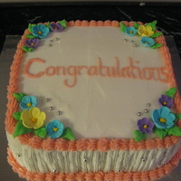 Congratulations Cake Sponge cake covered with Butter cream and Iced flowers