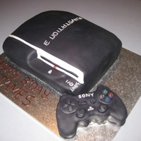 Playstation 3 Chocolate swirl sponge cake covered with fondant. Control made from krispie treats and covered with Fondant. This was a hit with the older...