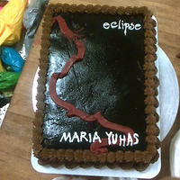 "You Bet It's A Twilight Themed Cake... Yeah. The ""Eclipse"" cover on a 1/4 sheet cake. I didn't have a tip any wider for the ribbon, which is sad. But there you..."