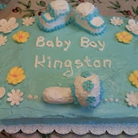 My First Baby Shower Cake vanilla cake with whipped icing, shoes and radder are from cereal treats