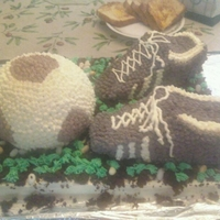 "Soccer Cake ""field"" is strawberry cake, shoes are chocolate cake and ball is yellow cake. Shoes are carved out and it was my first time. I..."