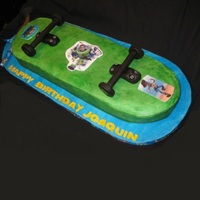 Toystory Skateboard Cake  Skateboard shape was cut from a sheet cake and iced in Sugarshack bc. Trunks and wheels made from fondant/tylose/modeling chocolate mix....