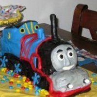 Thomas The Tank Engine!  My first 3D carved cake. My son is Thomas crazy and this was for his 3rd birthday. All fondant. He was thrilled was it! Made all the work...