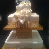 Ivory & Gold Wedding Cake I was given a picture to copy off I think I did a good job.