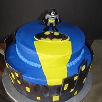 Batman Cake Cake made for a friend's son. She found a picture of a cake she liked and asked me to recreate. Butter cake, buttercream icing, and...