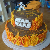 Star Wars The flames are orange tinted buttercream. I used red icing color to stripe the bag before piping the flames with leaf tips. The storm...