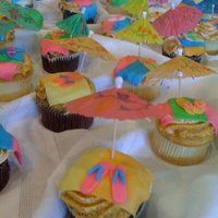Beach Theme Cupcakes The towels and flip flops are made with fondant. I made eighty of these for a beach themed party, so it took a long time, but they were...