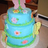 Butterflies And Flowers I used buttercream for everything except the flowers and butterflies. The butterfly on top was made with fondant and then set on top of a...