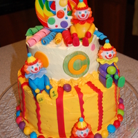 Clown First Birthday bottom layer chocolate fudge with bavarian cream filling top layer french vanilla with the same filling.