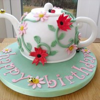 70Th Birthday Teapot Cake I made this for my mother in law who is 70 tomorrow. It started off more rounded but I decided to remove the bottom layer of cake as I just...