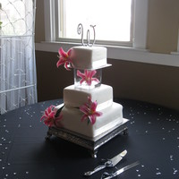 Square Cake With Glass Seperator square fondant wedding cake with glass seperator.