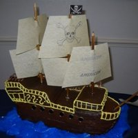 Pirate Ship By Sandi Pirate ship was one of three cakes made for a corporate party for Americom. It was flavored Chocolate Kaluah with chocolate fondant.